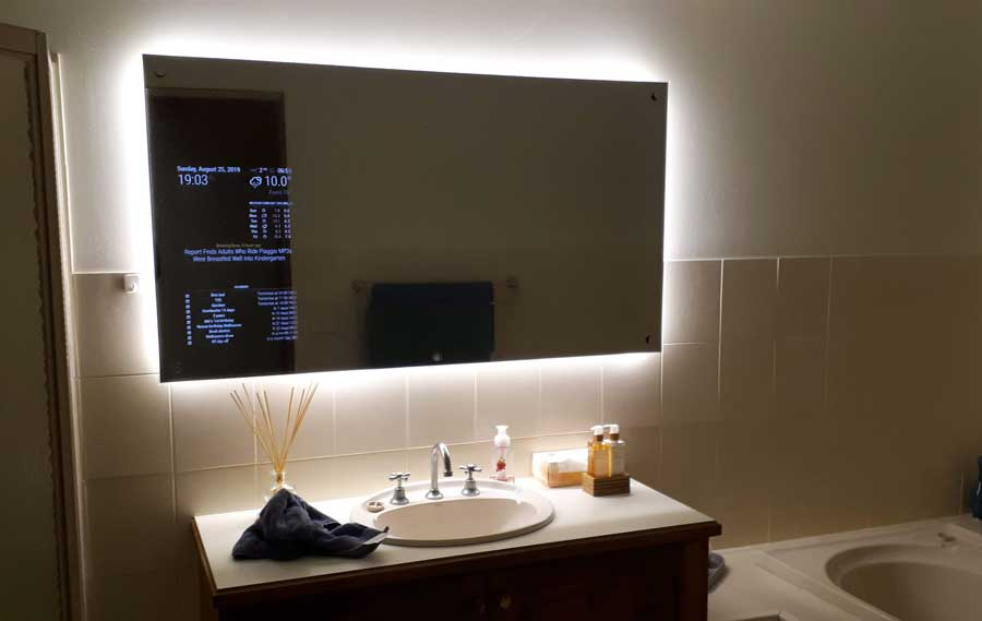 Large smart mirror with LEDs in bathroom